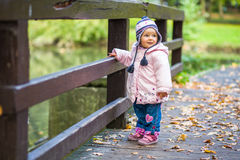 Infant baby girl in park Royalty Free Stock Photos