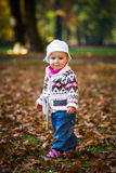 Infant baby girl in park Royalty Free Stock Photography