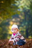 Infant baby girl in park Stock Photography