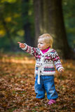 Infant baby girl in park Royalty Free Stock Photo