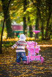 Infant baby girl in park Stock Image