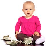 Infant baby girl playing with money Royalty Free Stock Photos