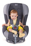 Infant baby girl sitting in a car seat Royalty Free Stock Photography