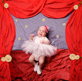 Infant baby girl wearing white ballerina tutu and crocheted ballet slippers. Infant baby girl wearing white ballerina tutu and crocheted  ballet slippers Stock Images