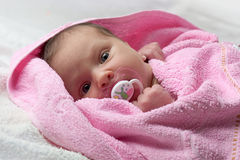 Infant baby in pink towel Royalty Free Stock Photos