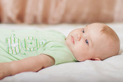 Infant baby playing  at home Stock Image