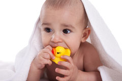 Infant baby playing with yellow duck after bath Royalty Free Stock Photos