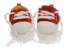 Infant or baby shoes. Red infant or baby running shoes with reflection on white background Royalty Free Stock Photos