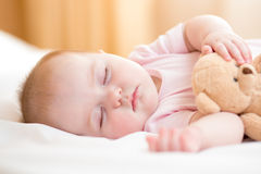 Infant baby sleeping. Infant baby girl sleeping on bed Royalty Free Stock Photography