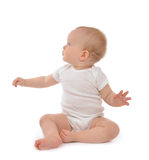 Infant baby toddler sitting hand pointing and looking up Royalty Free Stock Images