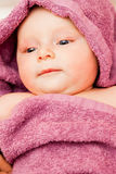 Infant baby in violet towel Royalty Free Stock Images