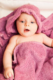 Infant baby in violet towel Stock Photography