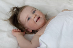 Infant baby woke up and smile Royalty Free Stock Photography