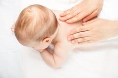 Infant back massage Stock Images