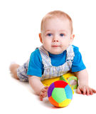 Infant with ball. Sweet infant lying with toys in front of him Stock Images