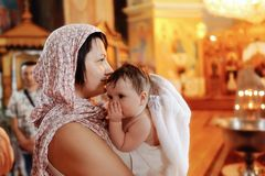 Infant baptism Stock Photo