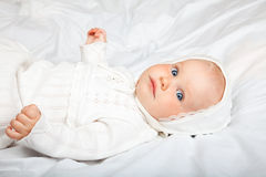 Infant in baptismal clothes Stock Image