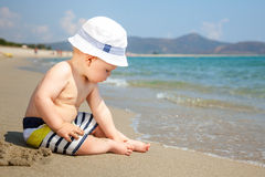 Infant on a beach Royalty Free Stock Photography