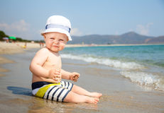 Infant on a beach Royalty Free Stock Photo