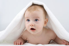 Infant below towel Stock Photo