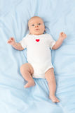 Infant on a blue diaper Royalty Free Stock Image