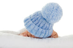 Infant with blue knit hat. Sleeping infant wearing a blue knit hat with a pompom Stock Images