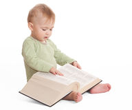 Infant with a book Stock Photo