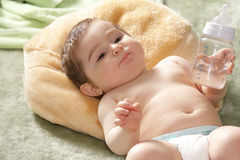 Infant with bottle closeup Stock Photography