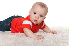 Infant boy on the carpet Royalty Free Stock Photo
