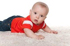 Infant boy on the carpet Royalty Free Stock Photo