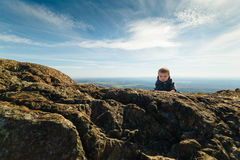 Infant boy climbing a mountain Royalty Free Stock Photography