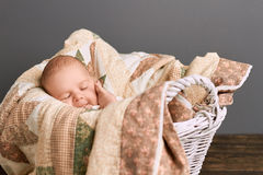 Infant boy with closed eyes. Stock Photo