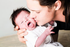 Infant boy with father. In studio Royalty Free Stock Image