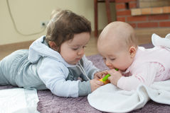 Infant boy and girl in mother club Stock Photos