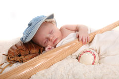 Infant Boy Holding Baseball Bat and Sleeping on a. Sleeping Infant Boy Holding Baseball Bat and Ball on White Background Royalty Free Stock Photos