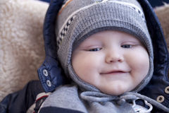 Infant boy is lying in a stroller in winter clothes Royalty Free Stock Photo