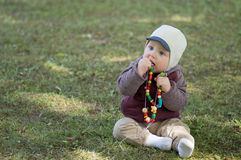 Infant boy play in park Stock Image