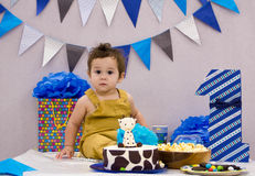 Infant boy`s first birthday cake smash Adorable baby smashing. Infant boy`s first birthday cake smash Adorable smashing cake Royalty Free Stock Image