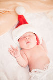 Infant boy in Santa hat Stock Images