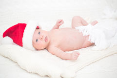Infant boy in Santa hat Stock Image