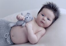 Infant boy with toy Royalty Free Stock Image