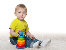 Infant boy with a toy Stock Photo