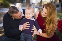 Infant Boy and Young Military Parents Play in the Park Royalty Free Stock Image