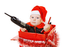 Infant calling by phone in the christmas box Stock Photos