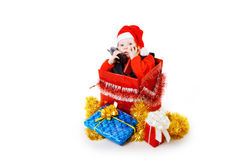 Infant calling by phone in the christmas box Stock Photography