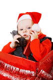 Infant calling by phone in the christmas box Royalty Free Stock Photo