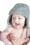 Infant in the cap smiling Royalty Free Stock Images