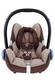 Infant car seat. An isolated brown infant carrier and car seat Stock Photography