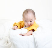 Infant child baby boy looking down Royalty Free Stock Images