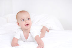 Infant child baby girl lying happy smiling on blanket Royalty Free Stock Images